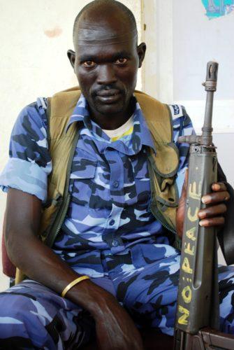 A policeman in Bentiu, northern South Sudan. Security actors can make or break peace, says Christian Aid report. Credit: Chris Milner